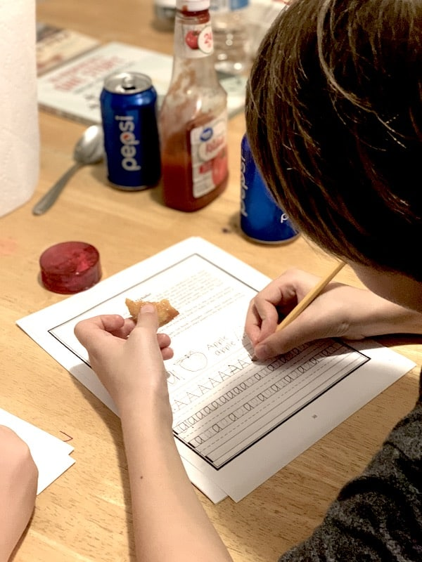 Daniel writing the letter A with the Italic Handwriting Curriculum with Everyday Education, the letter A